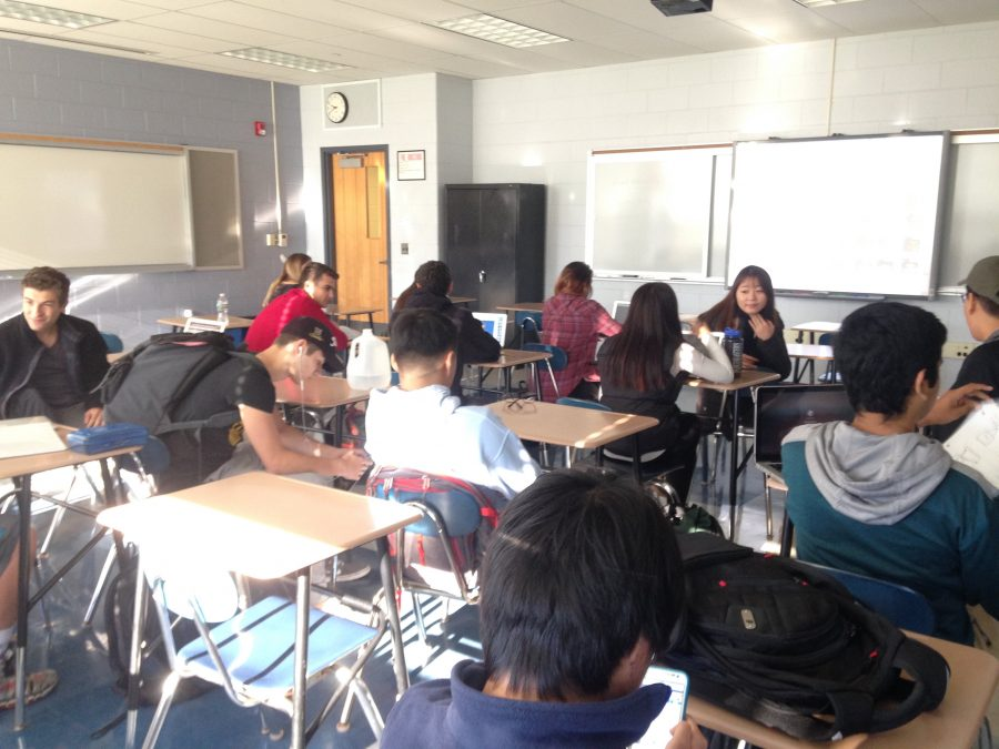 A dual-enrolled non-AP calculus class prepares for the day's lesson