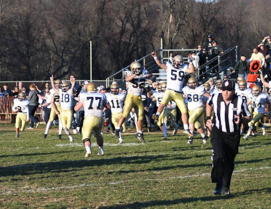 Football team celebrates after its win against Sparta. They will play River Dell at MetLife Stadium Friday, December 3rd.