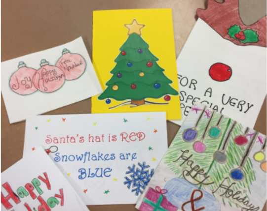 Students in the Red Cross Club made holiday cards for servicemen and women.