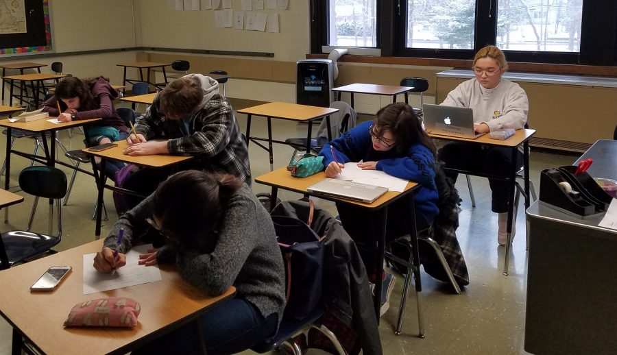 Students writing for the literary magazine, Coldwater writing