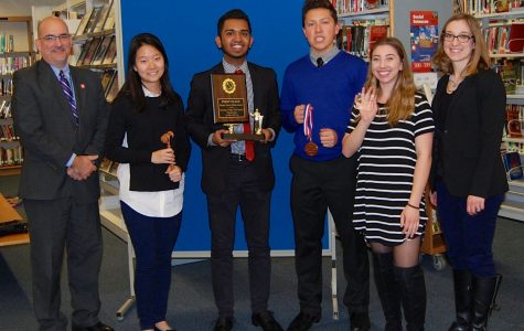 JV debate members keep time at second debate tournament