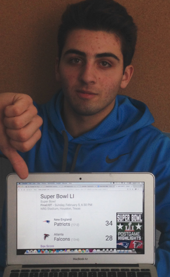 Senior Rich Guerriero reacts to the Patriots' win at Super Bowl LI