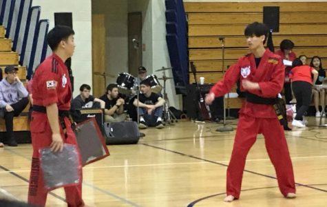 Taekwondo students kick back