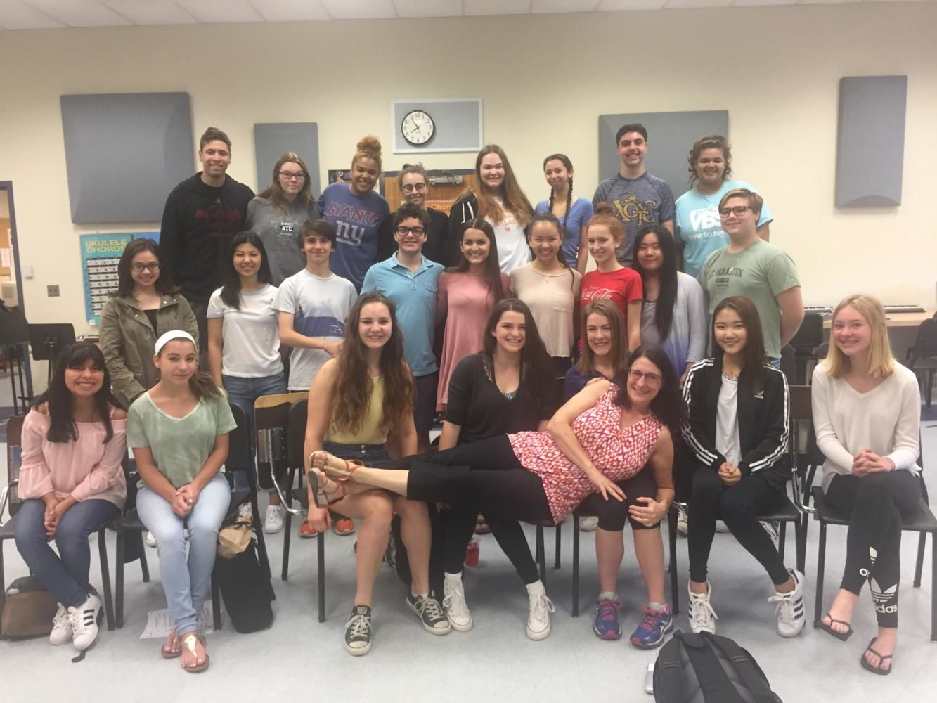 SING%21+Choir+teacher+Leslie+MacPherson+poses+with+her+class.+She+will+retire+at+the+end+of+this+year.