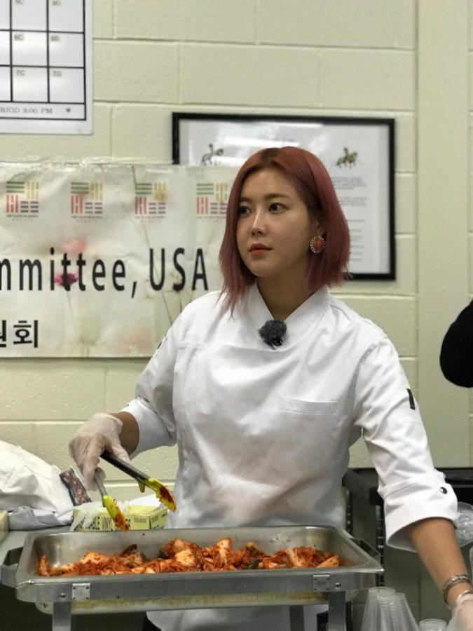 Solbi serves kimchi to students