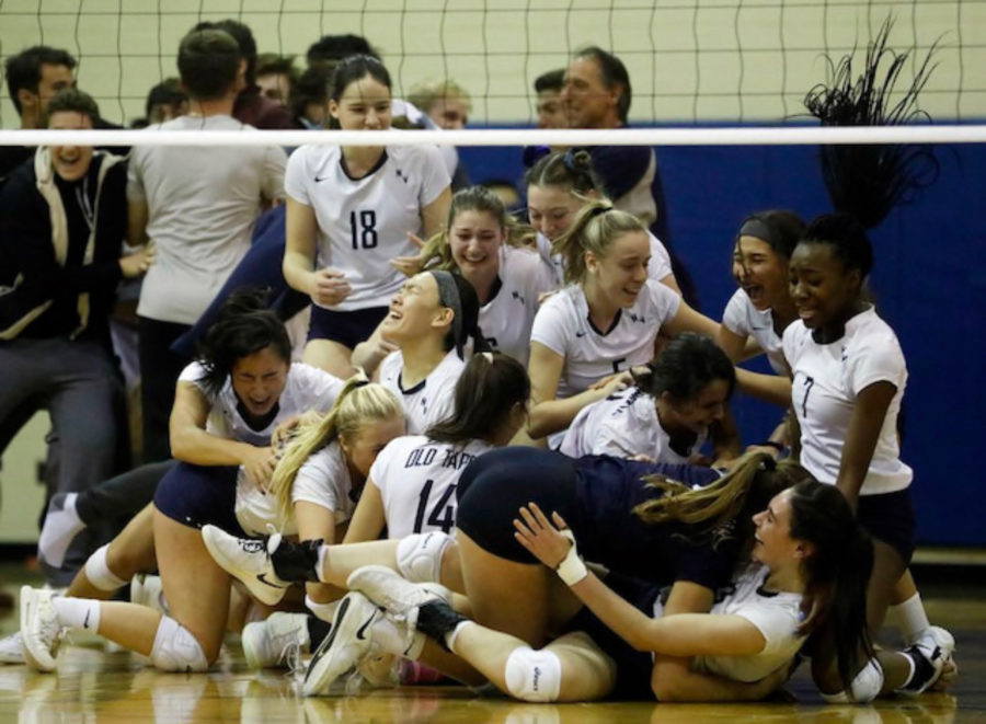 A family dog-pile follows the girls' victory against IHA.