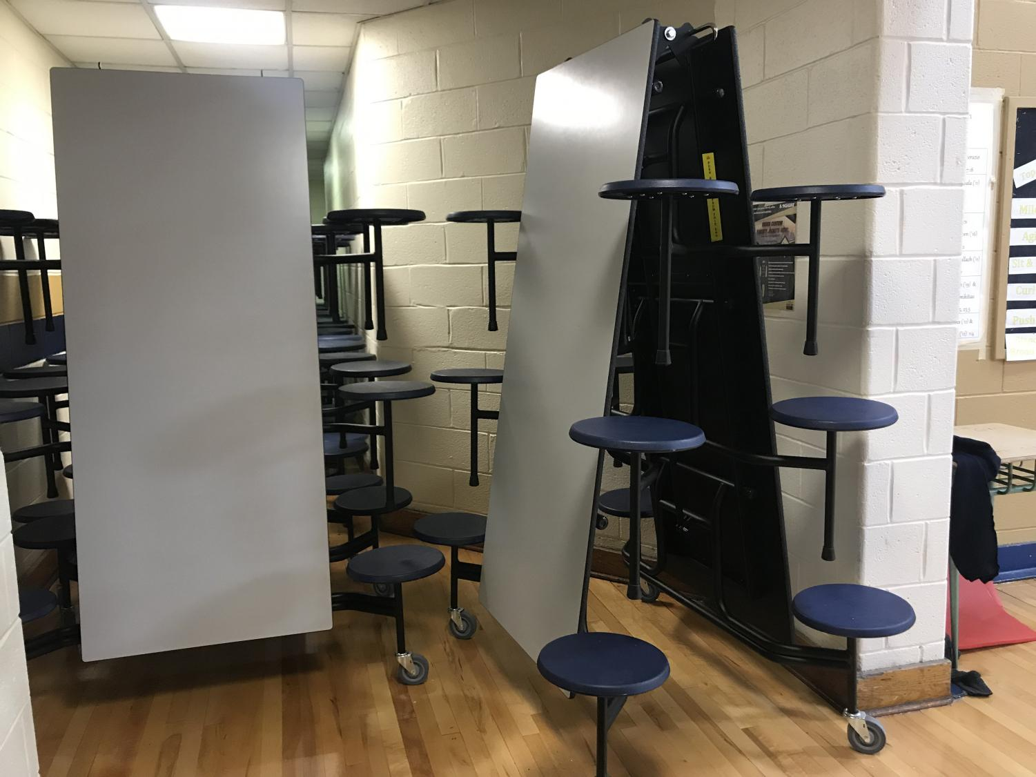 Tables are stored by the gym before students go to lunch
