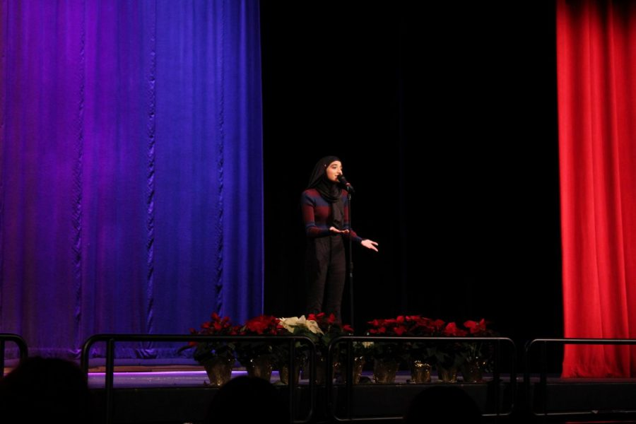 """Senior Rida Qureshi: """"This is my fourth poetry out loud. Freshman year I competed, and I placed second. Sophomore year I won the school competition, I won regionals, and I made it to finals.   My first poem is about the feeling that music gives the poet, so he's talking about how overwhelmed he is by how good it is. The second poem is a metaphor about race relations in the United States and stereotypes and how dogs don't have those stereotypes. The poet wishes for that simplicity.   It's all your jurisdiction, it's how you run it. You dictate what the poem means, it's not just someone else's words in your mouth, it's your words in your mouth."""""""