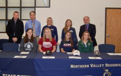 Samantha Martin, Kristen Brown, Samantha Derrico, and Jennifer Fernandez sign commitment letters.