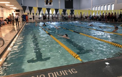 Swim team warming up for meet.