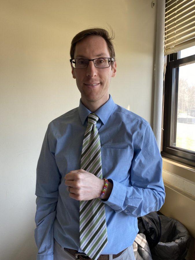 Dr. Nicholas Pellegrino shows off a tri-color bracelet
