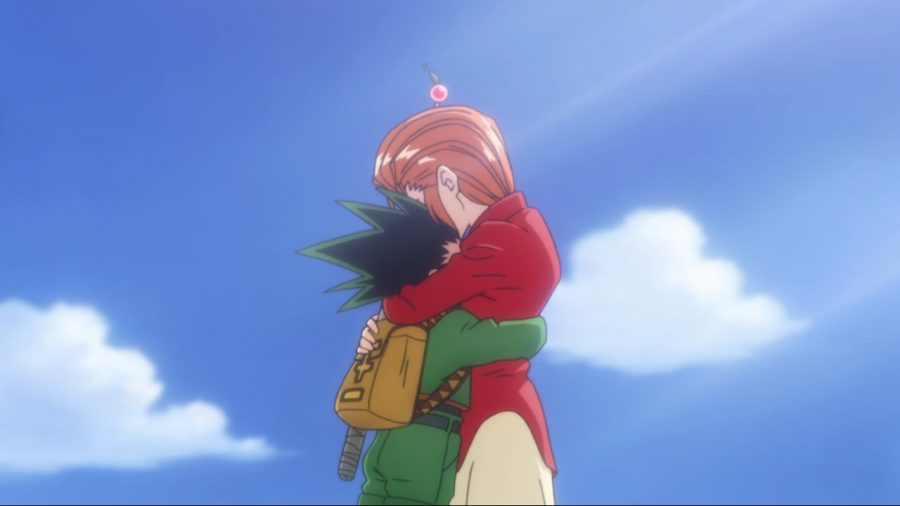 Gon hugs his caretaker, Mito, goodbye as he sets off to take the Hunter Exam.