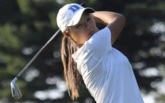 Bae swings her golf club during a tournament.