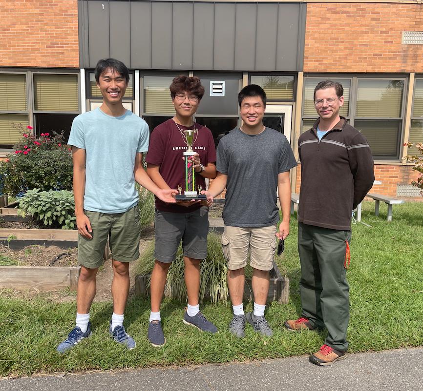 Seniors Daniel Zhao, Ace Kim, and Ethan Szeto with advisor Steve Maietta.